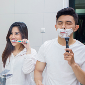 two people, shaving and brushing teeth