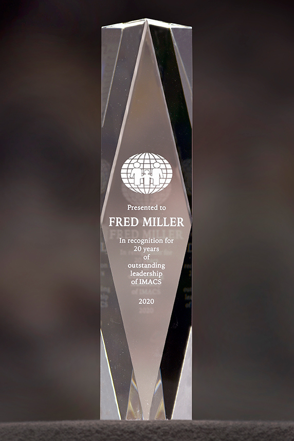 Miller's crystal, in recognition for 20 years of outstanding leadership of IMACS