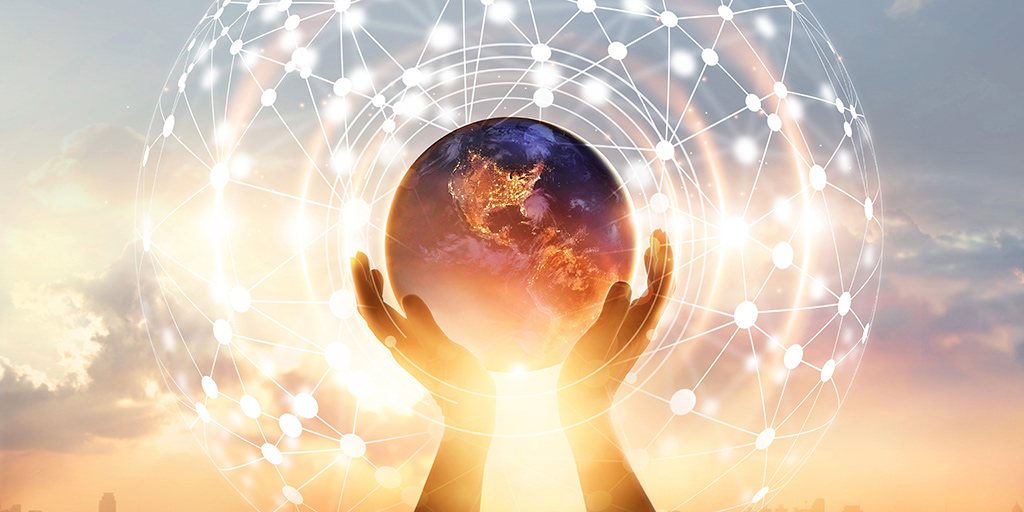 hands holding Earth and a circle global network connection